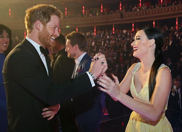Prince Harry greets Kacey Musgraves after the Royal Variety Performance on Nov. 13, 2015, in London. (Photo: WPA Pool via Getty Images)