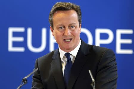 Britain's PM Cameron holds a news conference during an EU leaders summit in Brussels