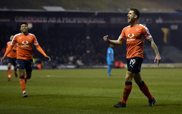 "Soccer Football - League Two - Luton Town vs Barnet - Kenilworth Road, Luton, Britain - March 24, 2018 Luton Towns James Collins celebrates scoring their second goal Action Images/Adam Holt EDITORIAL USE ONLY. No use with unauthorized audio, video, data, fixture lists, club/league logos or ""live"" services. Online in-match use limited to 75 images, no video emulation. No use in betting, games or single club/league/player publications. Please contact your account representative for further details."