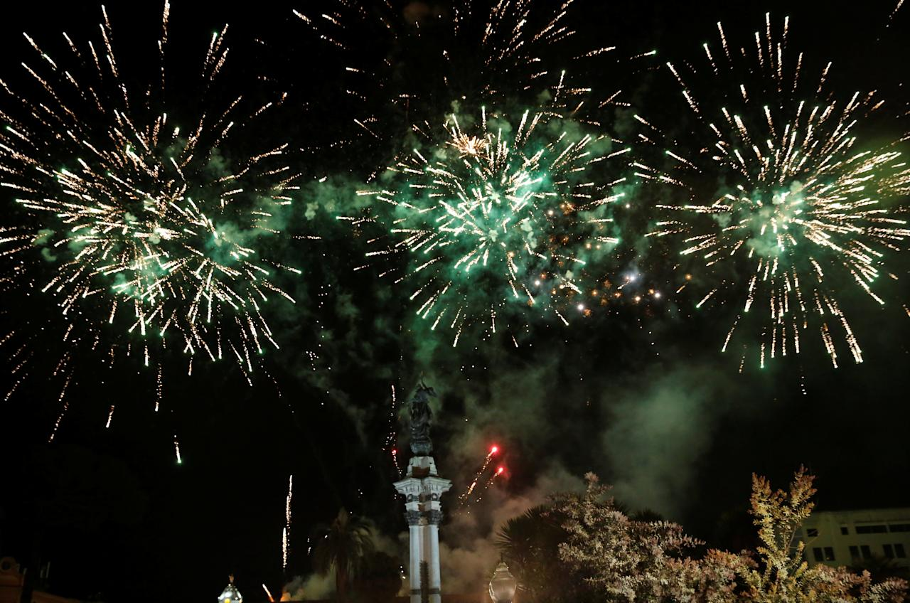Fireworks explode after Ecuador's President Lenin Moreno gave a speech to supporters from the government palace's balcony following his inauguration ceremony in Quito, Ecuador, May 24, 2017. REUTERS/Henry Romero