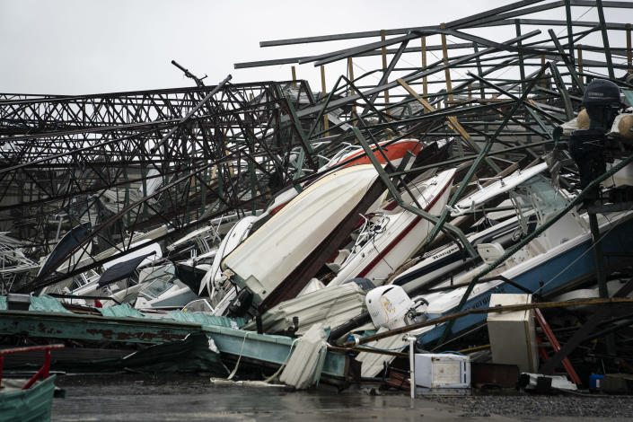 <p>A warehouse of boats is seen damaged at Treasure Island Marina after category 4 Hurricane Michael made land fall along the Florida panhandle, on Wednesday, Oct. 10, 2018 in Panama City Beach, Fla. (Photo: Jabin Botsford/The Washington Post via Getty Images) </p>