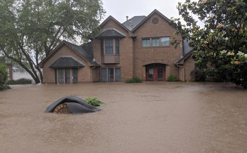 Flood waters surround homes in Fort Smith, Ark., Wednesday, May 29, 2019. Flood waters from the Arkansas River continue to rise. (AP Photo/Hannah Grabenstein) ORG XMIT: RPHG103