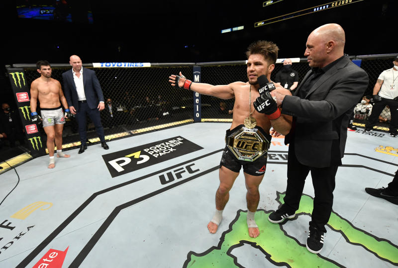 JACKSONVILLE, FLORIDA - MAY 09: Henry Cejudo announces his retirement in the Octagon after his victory over Dominick Cruz in their UFC bantamweight championship fight during the UFC 249 event at VyStar Veterans Memorial Arena on May 09, 2020 in Jacksonville, Florida. (Photo by Jeff Bottari/Zuffa LLC)