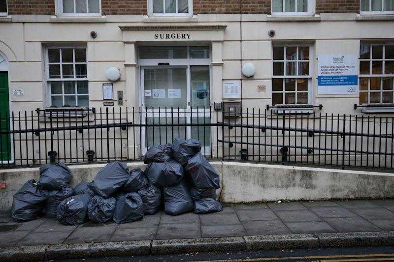 Bags of rubbish on the pavement outside the Ritchie Street Health Centre in Islington, which was closed for 'operational reasons' (PA)