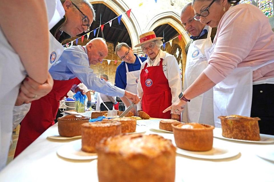 Judging is under way at the Annual British Pie Awards at St Mary's Church in Melton Mowbray, Leicestershire (Jacob King/PA) (PA Wire)