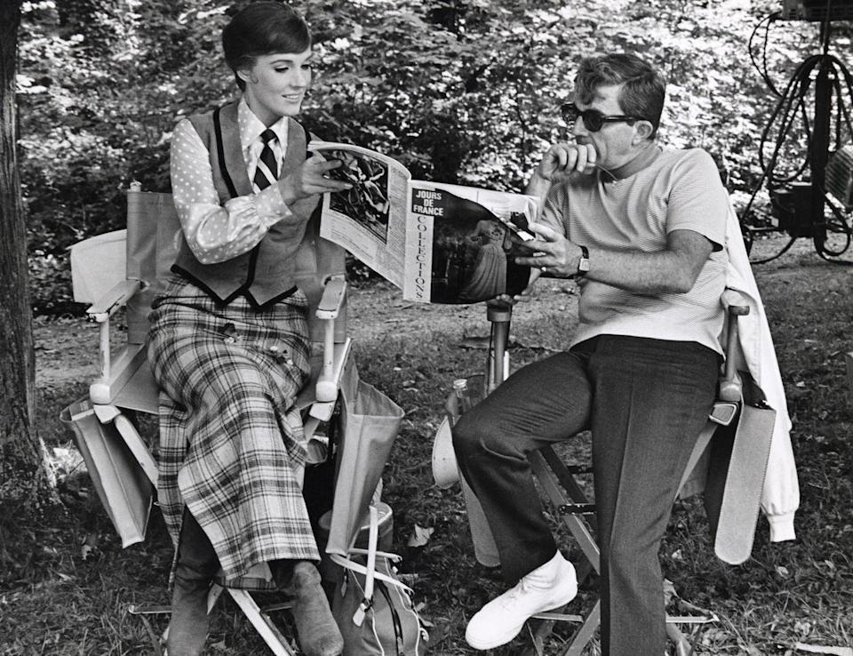 """<p>Andrews sits with her future-husband Blake Edwards on the set of """"Darling Lili."""" The two got married the next year. </p>"""