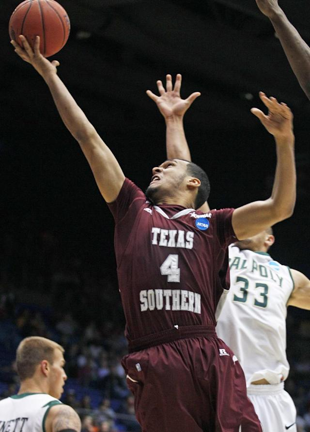 Texas Southern forward Jose Rodriguez (4) drives past Cal Poly forward Chris Eversley (33) in the first half of a first-round game of the NCAA college basketball tournament on Wednesday, March 19, 2014, in Dayton, Ohio. (AP Photo/Skip Peterson)