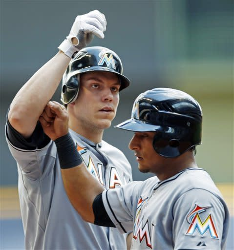 Miami Marlins' Logan Morrison, left, is greeted by Donovan Solano after hitting a two-run home run off of Milwaukee Brewers' Marco Estrada during the first inning of a baseball game, Tuesday, July 3, 2012, in Milwaukee. (AP Photo/Tom Lynn)