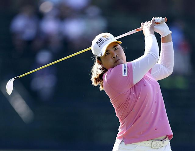 Inbee Park, of South Korea, watches her tee shot on the 13th hole during the first round of the U.S. Women's Open golf tournament in Pinehurst, N.C., Thursday, June 19, 2014. (AP Photo/Bob Leverone)