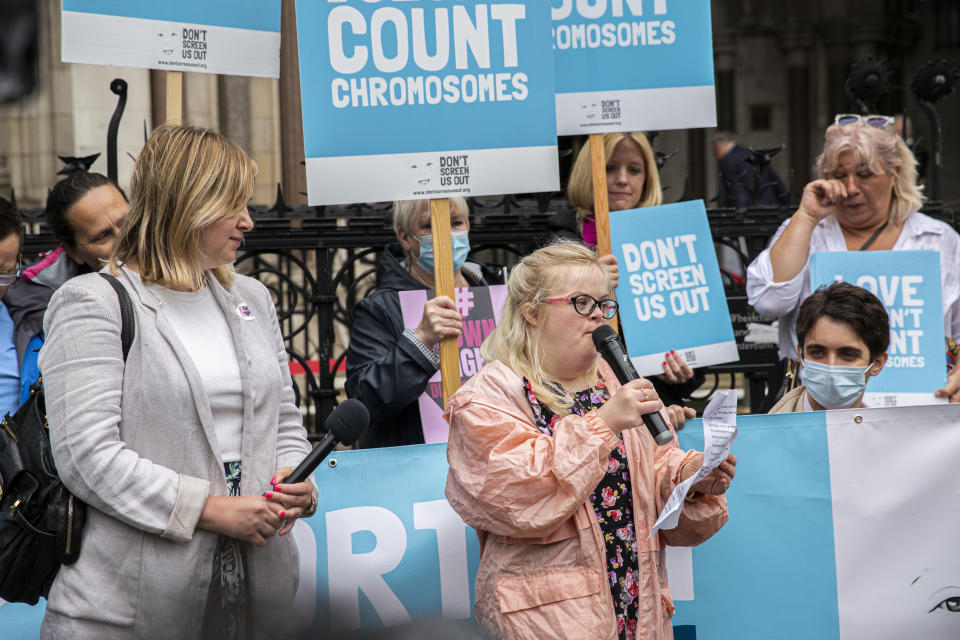 Heidi Crowter, front right, photographed at her High Court appeal, with Don't Screen Us Out, in London. (Supplied)