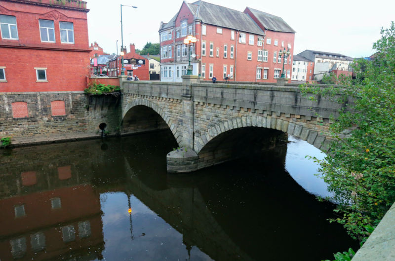 A baby boy has been died after reportedly being thrown from a bridge in Manchester