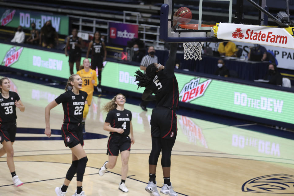 Stanford's Francesca Belibi (5) dunks the ball against California during the first half of an NCAA college basketball game, Sunday, Dec. 13, 2020, in Berkeley, Calif. (AP Photo/Jed Jacobsohn)