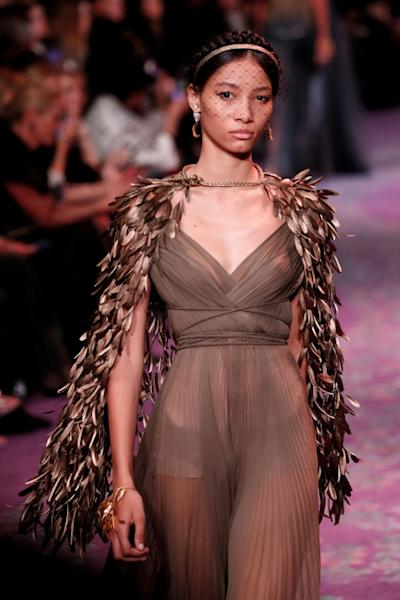 Dominican supermodel Lineisy Montero wore a feathered cape fit for Cleopatra (AFP Photo/FRANCOIS GUILLOT)