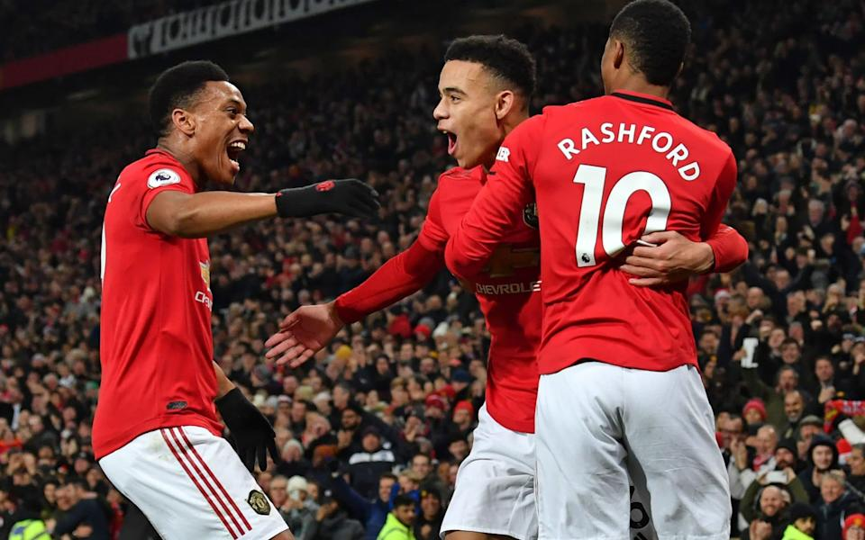 Mason Greenwood (C) celebrates with Manchester United's French striker Anthony Martial (L) and Manchester United's English striker Marcus Rashford (R) after scoring their second goal during the English Premier League football match between Manchester United and Newcastle United - GETTY IMAGES
