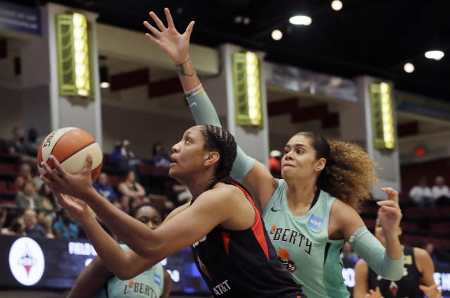 Las Vegas Aces' A'ja Wilson, left, drives past New York Liberty's Amanda Zahui B, of Sweden, during the first quarter of a WNBA basketball game, Sunday, June 9, 2019, in White Plains, N.Y. (AP Photo/Mark Lennihan)