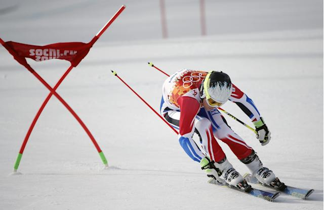 France's Alexis Pinturault passes a gate in the first run of the men's giant slalom at the Sochi 2014 Winter Olympics, Wednesday, Feb. 19, 2014, in Krasnaya Polyana, Russia. (AP Photo/Christophe Ena)