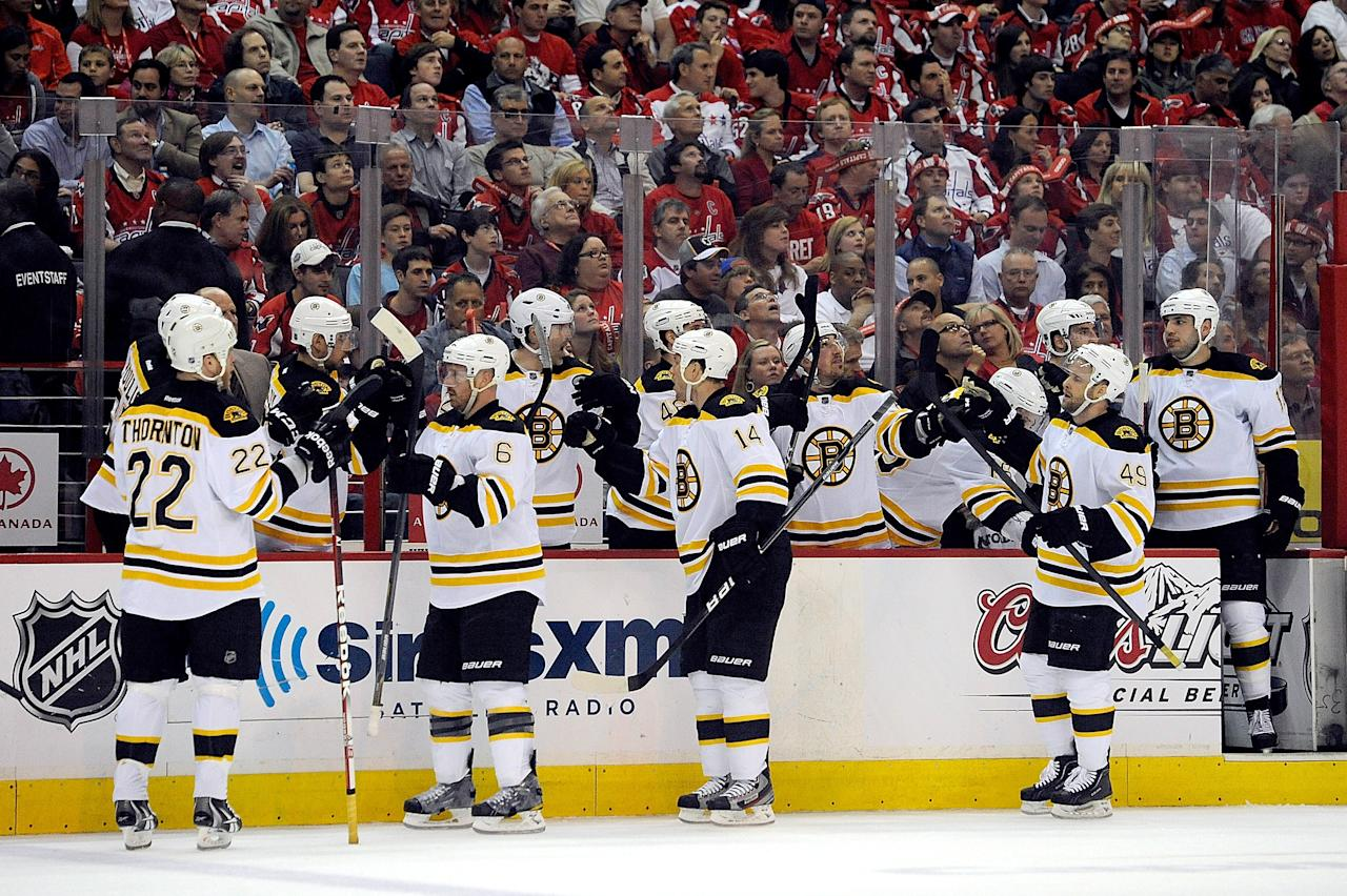 WASHINGTON, DC - APRIL 19:  The Boston Bruins celebrate after Rich Peverley #49 scores a goal against the Washington Capitals in Game Four of the Eastern Conference Quarterfinals during the 2012 NHL Stanley Cup Playoffs at Verizon Center on April 19, 2012 in Washington, DC.  (Photo by Patrick McDermott/Getty Images)