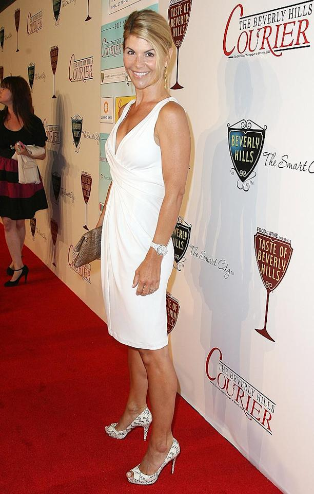 "46-year-old ""90210"" mom Lori Loughlin was taut and terrific in her formfitting white frock and coordinated snakeskin clutch and heels. Valerie Macon/<a href=""http://www.gettyimages.com/"" target=""new"">GettyImages.com</a> - September 2, 2010"