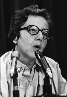 A woman at a microphone.