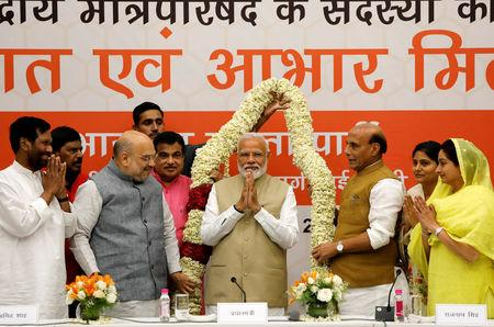 India's Prime Minister Narendra Modi gestures as he is presented with a garland during a thanksgiving ceremony by Bharatiya Janata Party (BJP) leaders to its allies at the party headquarters in New Delhi, India, May 21, 2019. REUTERS/Anushree Fadnavis