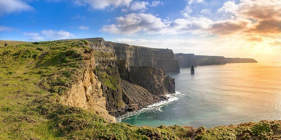 """<p><a href=""""https://www.bestproducts.com/fun-things-to-do/g3506/best-hotels-in-ireland/"""" rel=""""nofollow noopener"""" target=""""_blank"""" data-ylk=""""slk:Ireland"""" class=""""link rapid-noclick-resp"""">Ireland</a> is known for its lush scenery — they don't call it the Emerald Isle for nothing! — and one of the most stunning natural attractions are the <a href=""""https://www.tripadvisor.com/Attraction_Review-g1184916-d214806-Reviews-Cliffs_of_Moher-Liscannor_County_Clare.html"""" rel=""""nofollow noopener"""" target=""""_blank"""" data-ylk=""""slk:Cliffs of Moher"""" class=""""link rapid-noclick-resp"""">Cliffs of Moher</a> on the western coast of County Clare. Reaching 702 feet high, these jagged limestone cliffs stretch for 5 miles along the Atlantic Ocean coastline to create an awe-inspiring panorama. </p>"""