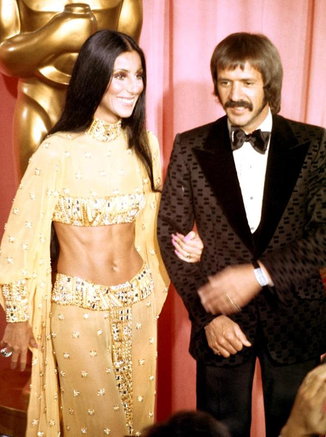 <p>Cher went to great lengths to make her hair stand out. She wore it pin-straight and parted down the middle, as many other women did in the days of <i>The Brady Bunch</i> and mood rings, but Cher wore it hanging down to her waist as she traded barbs back and forth with Sonny Bono on <i>The Sonny & Cher Comedy Hour</i>. (Photo: Michael Ochs Archives/Getty Images) </p>