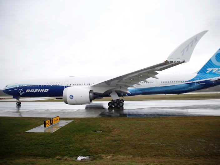 A Boeing 777X taxing back to its hangar.