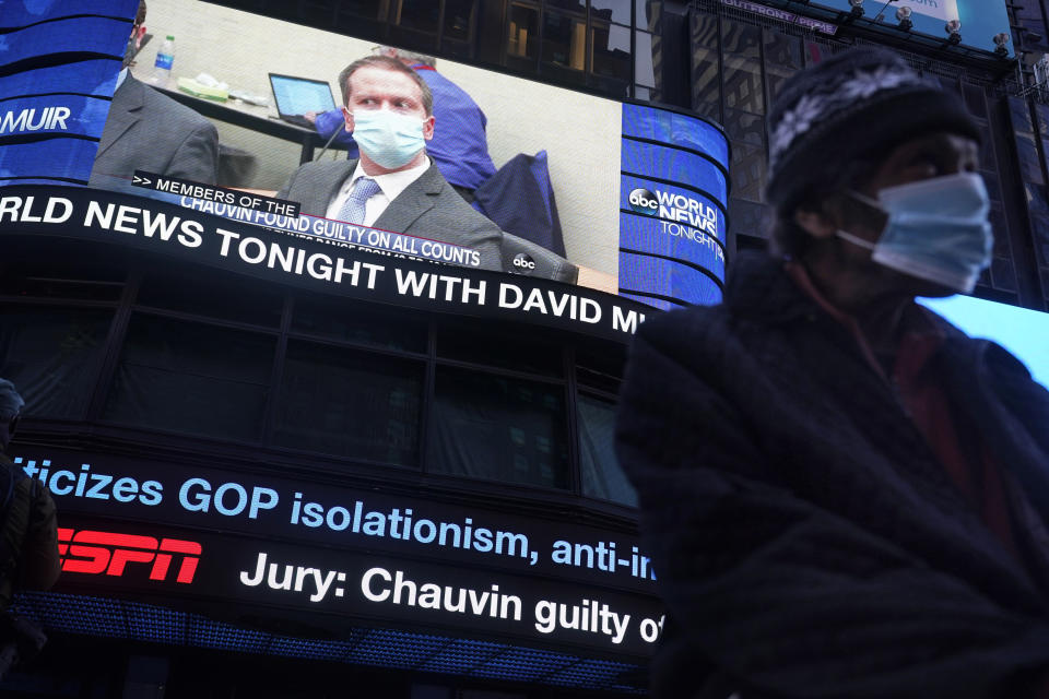 News of the verdict in the trial of former Minneapolis police Officer Derek Chauvin is displayed on a billboard in Times Square, New York, Tuesday, April 20, 2021. Chauvin has been convicted of murder and manslaughter in the death of George Floyd, the explosive case that triggered worldwide protests, violence and a furious reexamination of racism and policing in the U.S. (AP Photo/Seth Wenig)