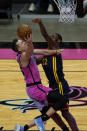 Miami Heat guard Duncan Robinson (55) drives to the basket as Golden State Warriors forward Andrew Wiggins (22) defends during the second half of an NBA basketball game, Thursday, April 1, 2021, in Miami. (AP Photo/Marta Lavandier)