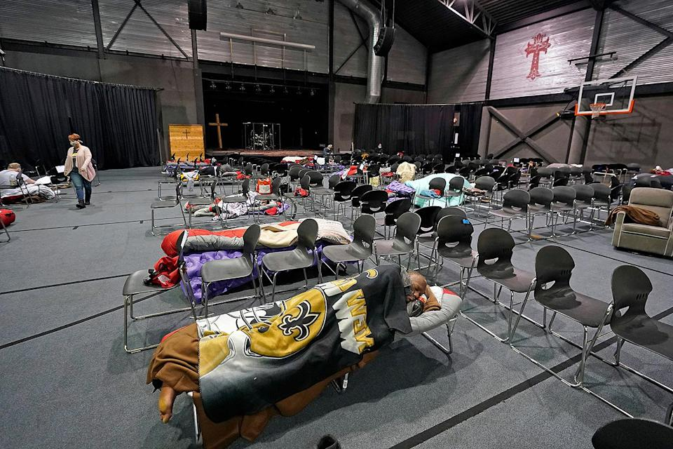 <p>People seeking shelter from below-freezing temperatures rest inside a church warming center in Houston on Feb. 17. </p>
