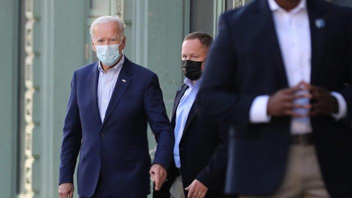 Wearing a face mask to reduce the risk posed by COVID-19, Democratic presidential nominee Joe Biden departs his live video campaign event Saturday in Wilmington, Delaware. (Photo by Chip Somodevilla/Getty Images)