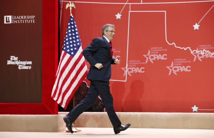 Jeb Bush runs off stage after speaking at the Conservative Political Action Conference (CPAC) at National Harbor in Maryland  February 27, 2015.  (Kevin Lamarque/REUTERS)