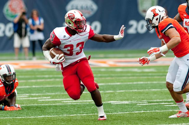 Western Kentucky runningback Leon Allen (33) runs the ball during the first quarter of an NCAA college football game against Illinois, Saturday, Sep. 6, 2014, at Memorial Stadium in Champaign, Ill. (AP Photo/Bradley Leeb)