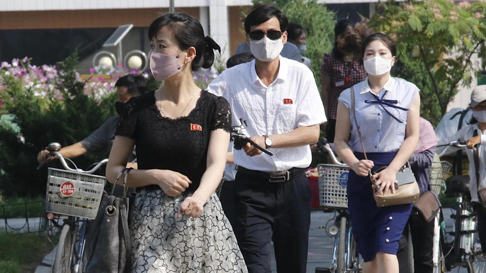 Pyongyang locals wearing face masks to prevent coronavirus.