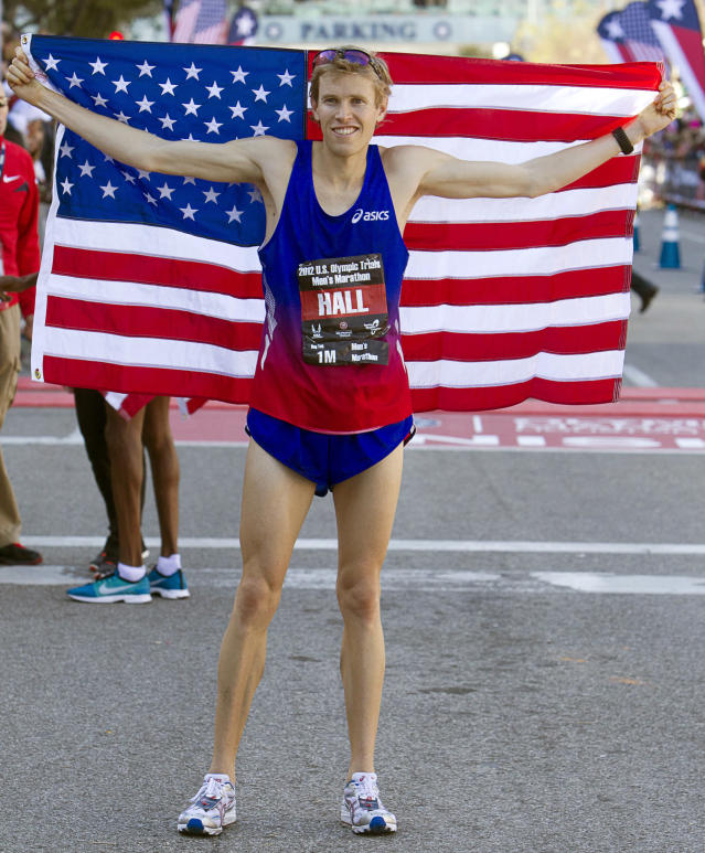 HOUSTON, TX - JANUARY 14: Ryan Hall poses with the American flag after finishing second with a time of 2:09:30 in the U.S. Marathon Olympic Trial on January 14, 2012 in Houston, Texas. (Photo by Bob Levey/Getty Images)