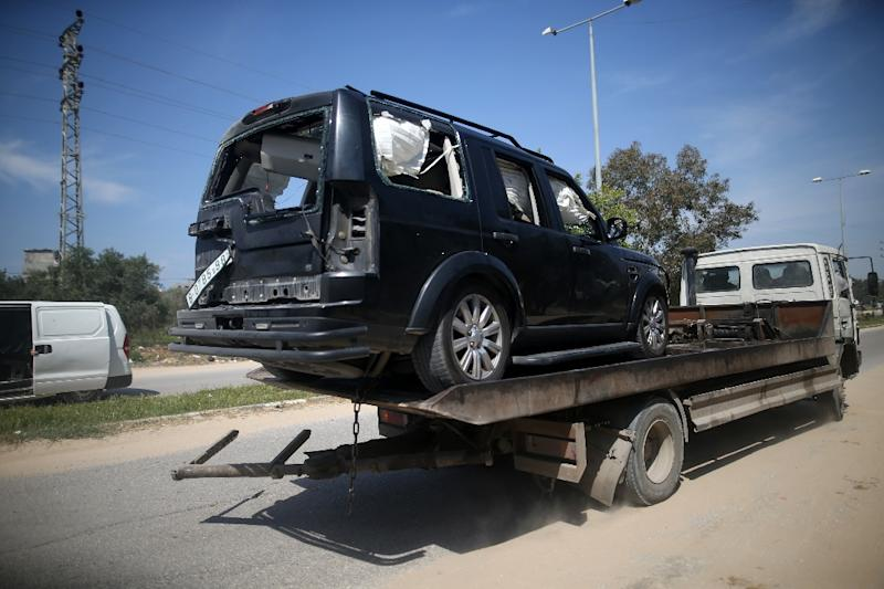 A vehicle from Palestinian prime minister Rami Hamdallah's convoy is carried away after it was hit by an explosion as he made a rare visit to Gaza on March 13, 2018 (AFP Photo/MOHAMMED ABED)