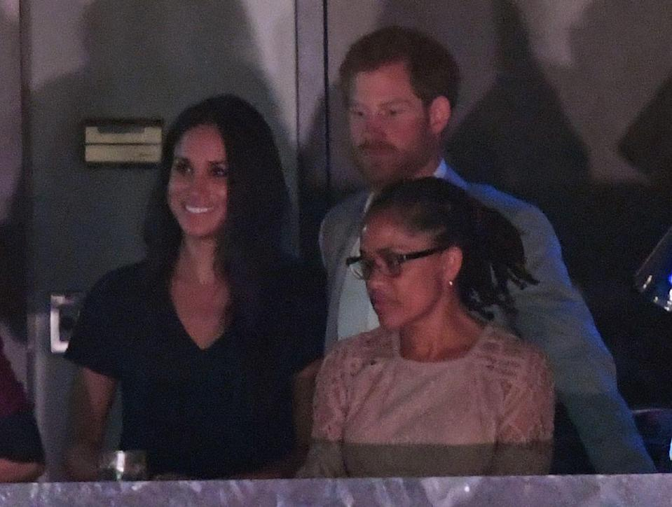 "<p>While Meghan was initially seated separately from Harry in a private box with her mother and close friends, he stopped by <a href=""https://www.townandcountrymag.com/society/tradition/a12458002/meghan-markle-prince-harry-invictus-games-toronto/"" rel=""nofollow noopener"" target=""_blank"" data-ylk=""slk:toward the end of the event to say hello"" class=""link rapid-noclick-resp"">toward the end of the event to say hello</a>. </p>"