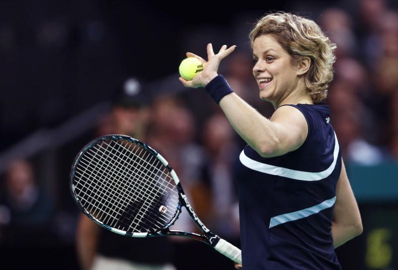 Belgium's Clijsters waves to supporters during an exhibition tennis match against Williams of the U.S. in Antwerp