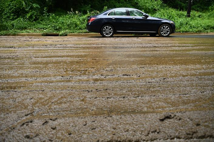 An abandoned car is left after the rain storm on Canal Road on July 8, 2019 in Washington, D.C. (Photo: Brendan Smialowski/AFP/Getty Images)