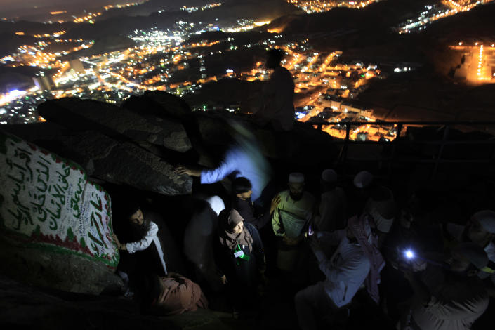 FILE - In this Wednesday, Nov. 2, 2011 file photo, Muslim pilgrims visit the Hiraa cave, at the top of Noor Mountain on the outskirts of Mecca, Saudi Arabia. As Muslims from all over the world congregate for the annual hajj pilgrimage, some are defying the edicts of Saudi Arabia's strict Wahhabi school of Islam by climbing al-Nour mountain in the hope of attaining spiritual favor. Hatreds between Shiites and Sunnis are now more virulent than ever in the Arab world because of Syria's brutal civil war. Hard-line clerics and politicians on both sides have added fuel, depicting the fight as essentially a war of survival for their sect. (AP Photo/Hassan Ammar, File)