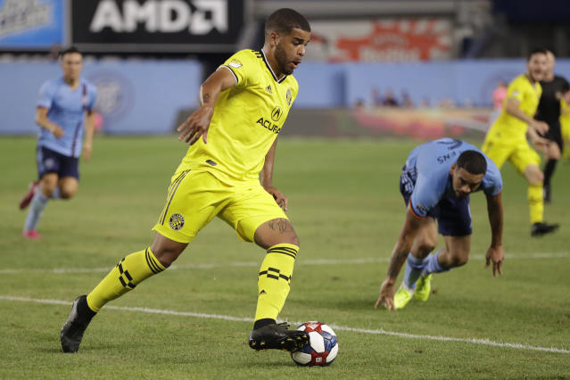 Columbus Crew forward Jordan Hamilton (5) controls the ball as New York City FC defender Alexander Callens, second from right, recovers from a spill during the second half of an MLS soccer match, Wednesday, Aug. 21, 2019, in New York. New York City FC defeated Columbus 1-0. (AP Photo/Kathy Willens)