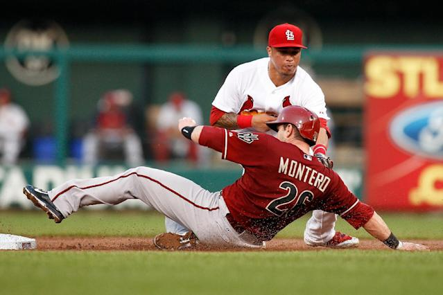 Arizona Diamondbacks' Miguel Montero is tagged out by St. Louis Cardinals second baseman Kolten Wong while attempting to steal second base during the second inning of a baseball game Wednesday, May 21, 2014, in St. Louis. (AP Photo/Scott Kane)