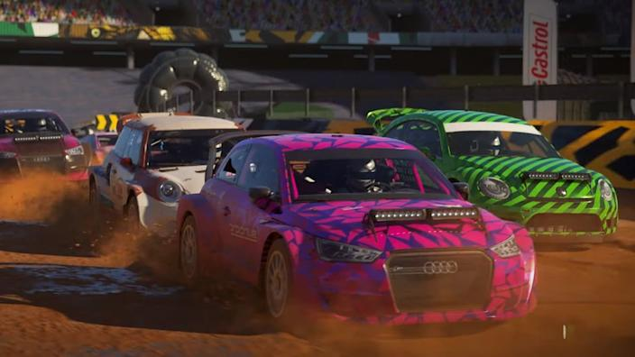 Rally cars go around a dirt track in this trailer screenshot for Dirt 5