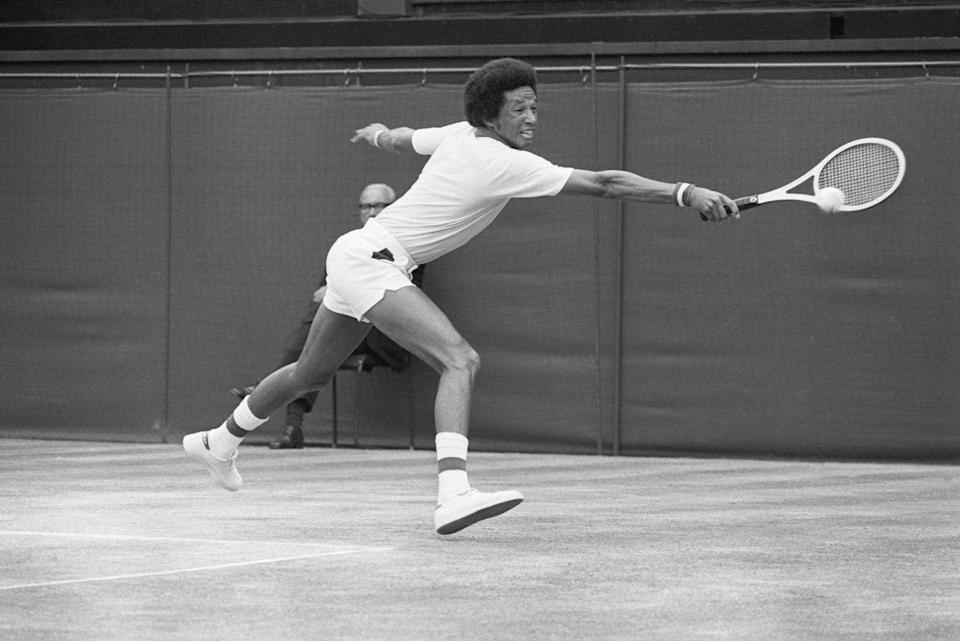 <p>Arthur Ashe hits a backhand return to Jimmy Connors during their men's singles title match at Wimbledon. Ashe won 6-1, 6-1, 5-7, 6-4 in 1975.</p>