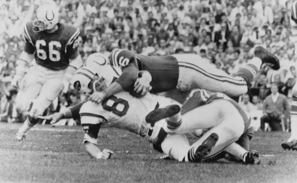 File-This Jan. 12, 1969 file photo shows New York Jets Pete Lammons (87) getting tackled during the Super Bowl in Miami, Fla. Lammons, a tight end on the New York Jets' Super Bowl-winning team in 1969, has died in a boating accident. He was 77. Major League Fishing announced in a statement Friday, April 30, 2021, that Lammons was participating in a fishing event on the Sam Rayburn Reservoir in Texas on Thursday morning when he slipped while boarding a boat, fell into the water, and drowned. (AP Photo/File)