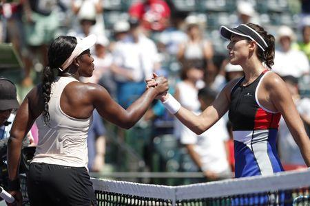 Mar 26, 2018; Key Biscayne, FL, USA; Sloane Stephens of the United States (L) shakes hands with Garbine Muguruza of Spain (R) after their match on day seven of the Miami Open at Tennis Center at Crandon Park. Stephens won 6-3, 6-4. Mandatory Credit: Geoff Burke-USA TODAY Sports