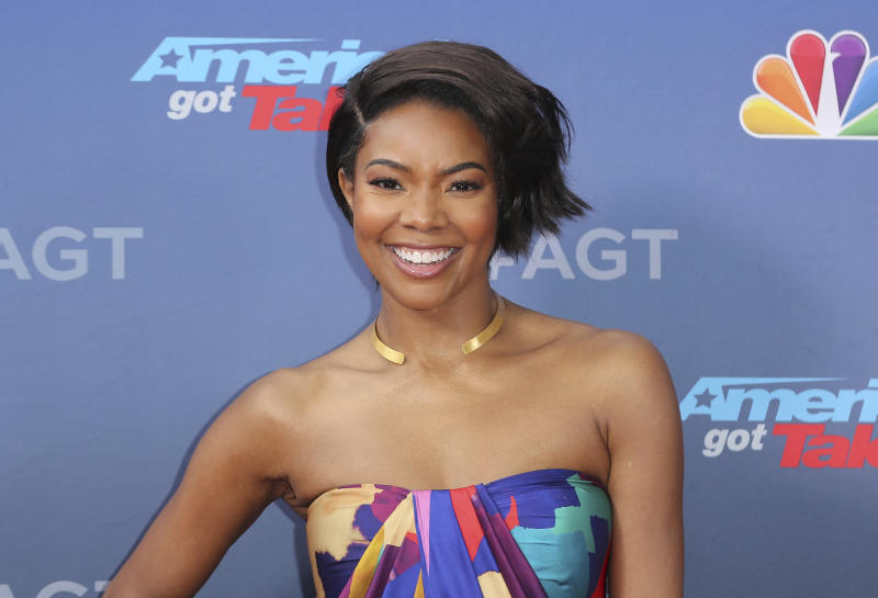 """FILE - This March 11, 2019 file photo shows Gabrielle Union at the """"America's Got Talent"""" Season 14 Kickoff in Pasadena, Calif.  Union is thanking supporters for defending her amid reports she was fired from """"America's Got Talent"""" after complaining about racism and other on-set issues. Without directly addressing her status with NBC's talent show, the actress tweeted Wednesday that the backing helped overcome feeling of being lost and alone. (Photo by Willy Sanjuan/Invision/AP, File)"""