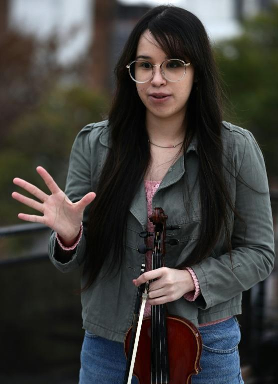 """Violinist Maria Andreyna Chavez says the orchestra's rehearsals have been a """"blessing"""" for the Venezuelan members"""