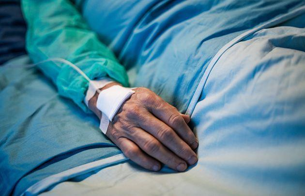 Close-up of old man in intensive care unit. (Photo: Halfpoint Images via Getty Images)