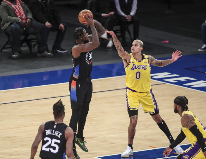 New York Knicks forward Julius Randle (30) shoots over Los Angeles Lakers forward Kyle Kuzma (0) in the first quarter of an NBA basketball game at Madison Square Garden in New York, Monday, April 12, 2021. (Wendell Cruz/Pool Photo via AP)